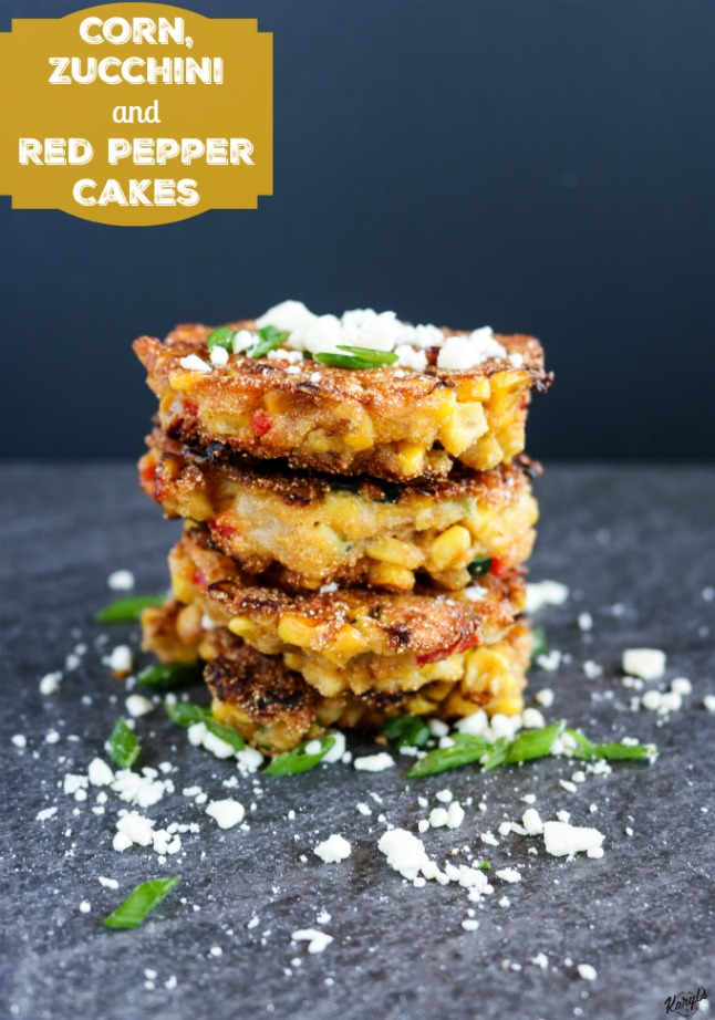close up shot of 4 corn cakes in a stack on a black platter