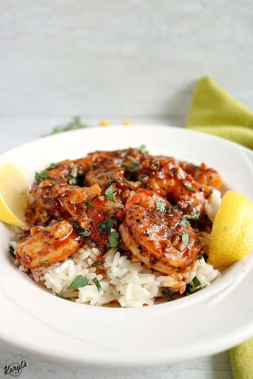 Spicy New Orleans Shrimp has an incredibly flavorful marinade that is spicy, but not overpowering. You will want to savor every drop of it! Serve shrimp on its own, over rice, or with crusty bread for dipping #seafood #shrimp #spicymarinade #bakedseafood #bakedshrimp #glutenfree #karylskulinarykrusade