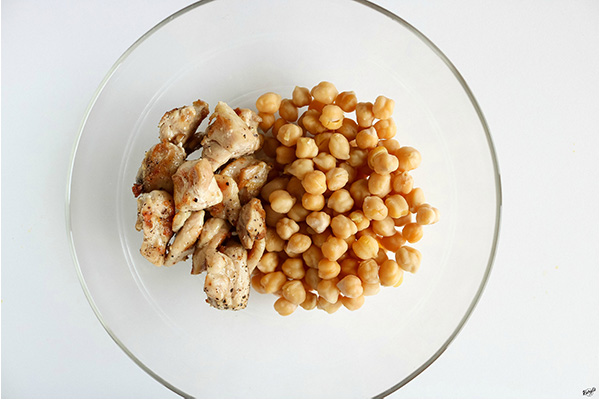 overhead shot of chickpeas and grilled chicken in a bowl