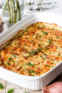 Herb Scalloped Sweet Potatoes with Gruyere and Bacon by Carlsbad Cravings