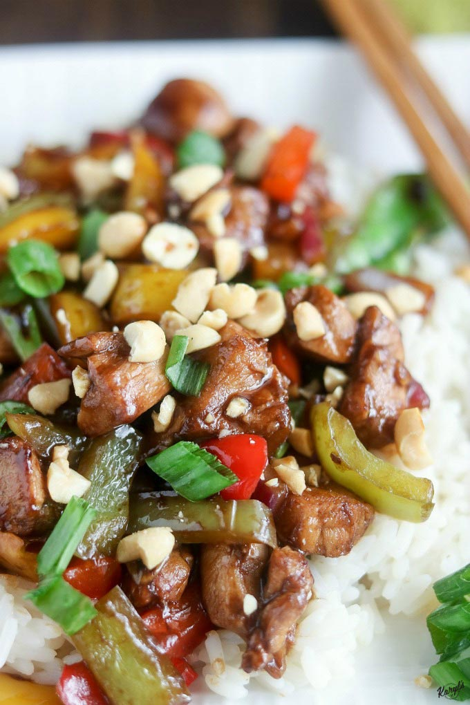 close up shot of finished Kung Pao chicken over rice