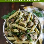 overhead shot of pesto chicken penne pasta in a white bowl