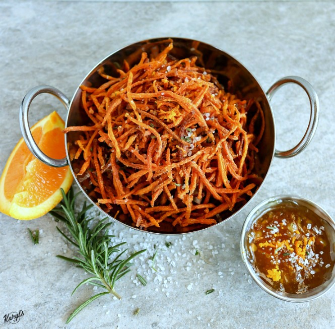 Matchstick Carrot Fries might be vegetables, but they sure taste like candy! These are a great way to get your kids to eat their veggies. Rosemary sea salt adds a distinctive bite and flavor that can't be beat #carrots #carrotfries #friedveggies #vegetables #vegan #glutenfree #sides #karylskulinarykrusade