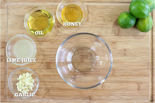 overhead process shot: marinade ingredients in small glass bowls