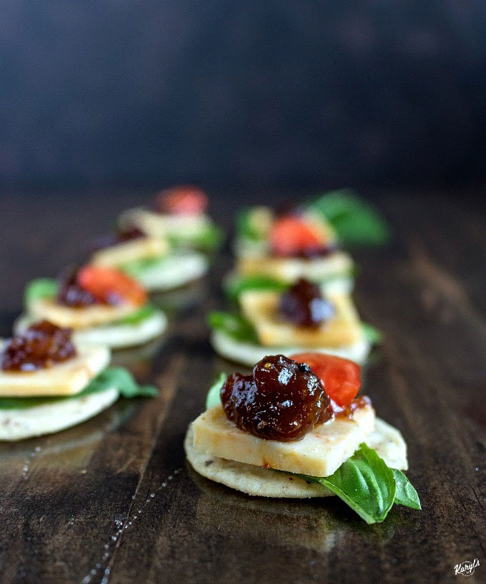 Cheddar Fig Honey Bites are a delicious, gluten free snack. Use a bold cheddar for bite, and the fig spread and honey create a wonderful contrast. in flavor. The crunchy crackers provide a perfect contrast in texture and make for a great snack your friends and family will love #cheese #crackers #basil #honey #rawhoney #glutenfree #snack #appetizer #fingerfood #bitesized #karylskulinarykrusade