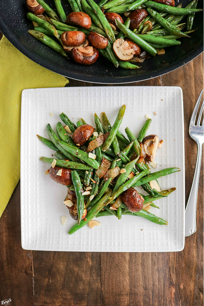 Green Bean Mushroom Saute is a simple, yet elegant dish. Perfect for weeknight dinner, or for entertaining. Serve it as a side with your favorite protein, or even on its own for a delicious vegetarian meal #beans #mushrooms #garlic #almonds #sides #holidays #entertaining #vegetables #veggies #vegetarian #glutenfree #cookingwithwine #karylskulinarykrusade