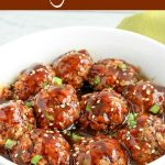 close up angled shot of finished meatballs and sauce in a white bowl