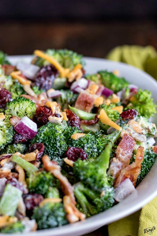 cropped shot of finished broccoli salad in a white bowl