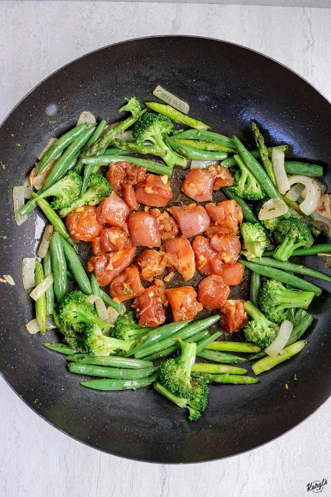Spicy Chicken Vegetable Stir Fry is a wonderfully spicy, hearty stir-fry meal that's perfect for lunch or dinner. Mix up your favorite veggies, and decide how spicy you want this dish #chicken #vegetables #stirfry #wokcooking #spicychicken #spicymarinade #glutenfree #karylskulinarykrusade