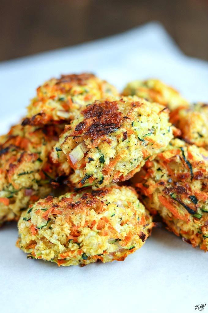 Baked Zucchini Carrot Tots stacked on parchment paper