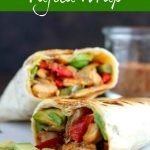 close up shot of finished chicken fajita wrap cut in half and layered on top