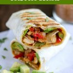 close up shot of finished chicken fajita wrap cut in half and stacked