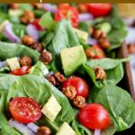 close up shot of finished spinach salad with no dressing