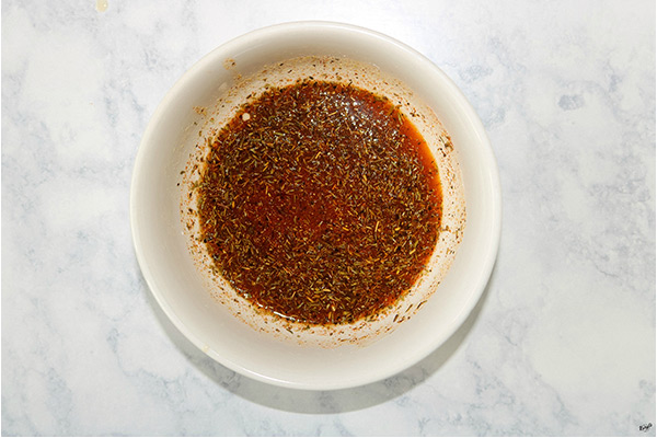 overhead shot of marinade ingredients in a white bowl