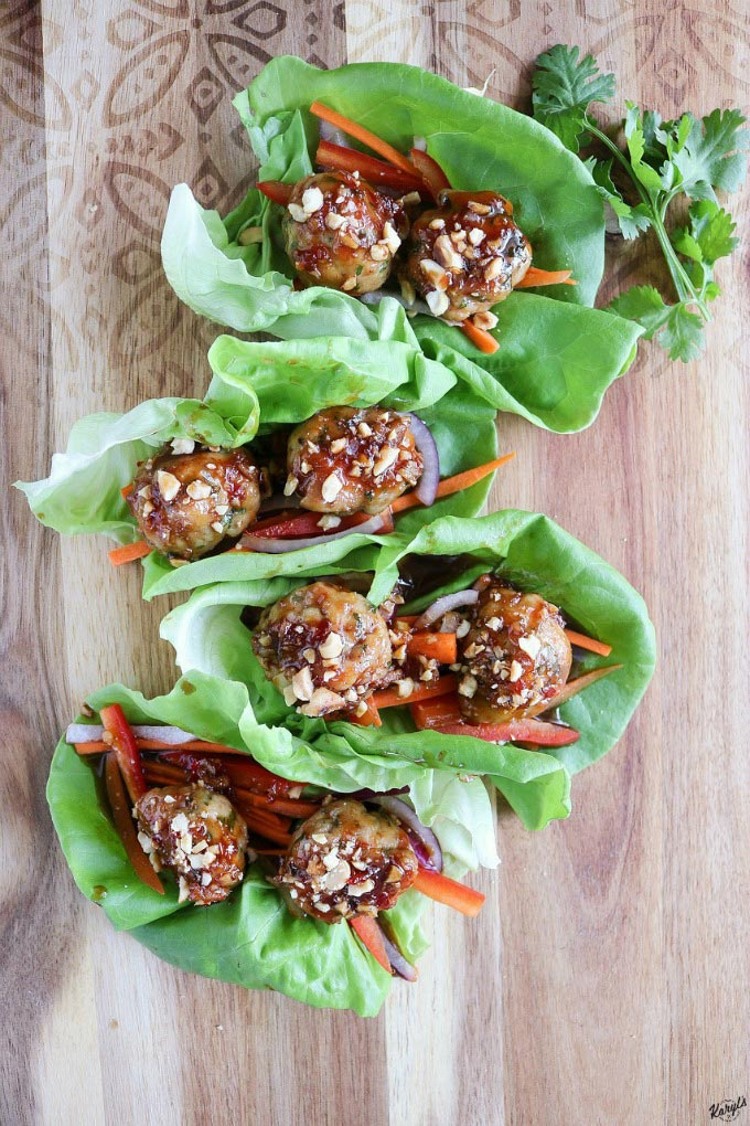 Thai Chicken Meatball Lettuce Cups have it all...bold flavors and a wonderful contrast of textures, all wrapped up in fresh lettuce leaves. Easy to make, and on the table in about 20 minutes #chicken #chickenmeatball #bakedmeatball #lettucecups #peanuts #easyrecipe #20minuterecipe #karylskulinarykrusade