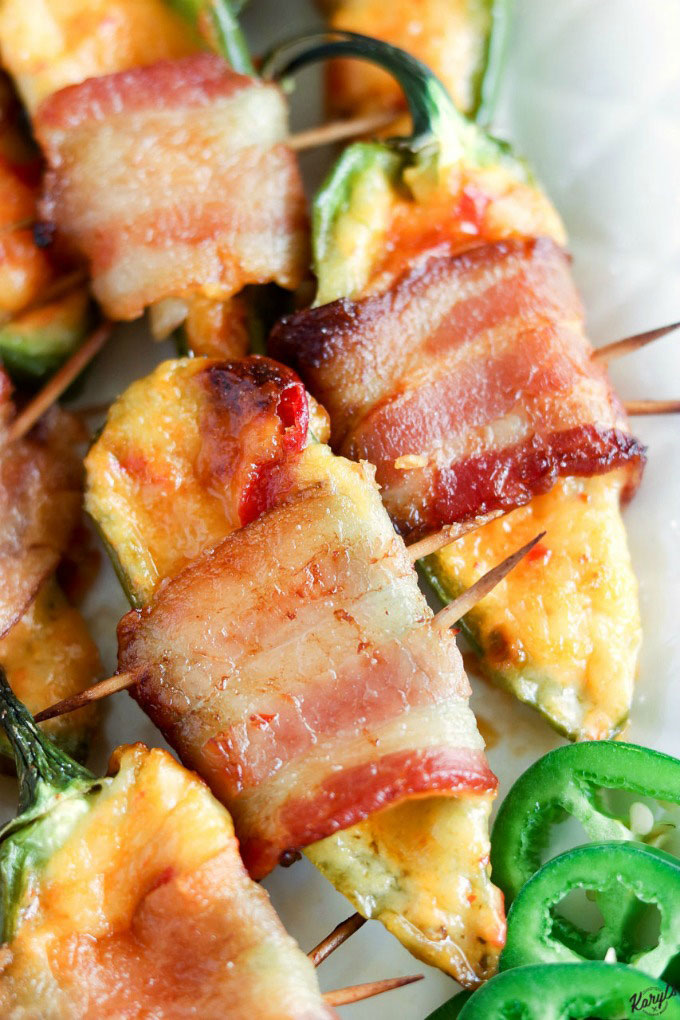 Bacon Pimiento Cheese Jalapeno Poppers will take your party spread to new levels! Using only 3 ingredients, these poppers are baked to perfection, and they'll be gone in a flash #bacon #pimientocheese #jalapenos #jalapenopoppers #glutenfree #appetizer #partyfood #gamedayfood #tailgatefood #easyrecipe #karylskulinarykrusade