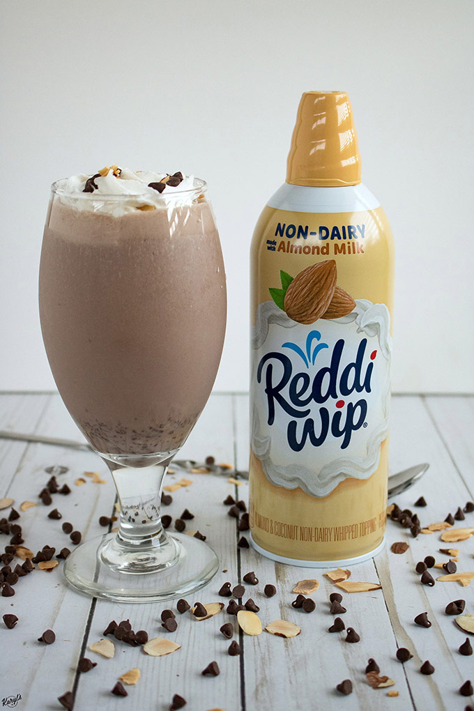 #Ad Almond Milk Chocolate Cookie Dough Shake has all the creamy, chocolaty goodness of a traditional milkshake, using all dairy-free ingredients. The crowning glory is Reddi-wip® Almond Non-dairy whipped topping #ReddiForNonDairy #CollectiveBias #dairyfree #reddiwip #whippedtopping #almondmilk #coconutmilkicecream #shake #dairyfreeshake #almonds #chocolate #karylskulinarykrusade