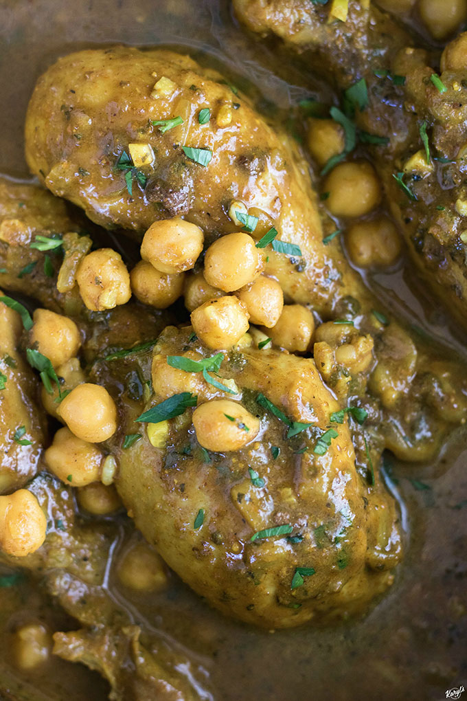 Curry Chicken and Chickpeas is traditional dish in Trinidad & Tobago. Madras curry powder provides the base of this bold and flavorful meal. Serve over rice or with roti bread to soak up every drop of gravy #chicken #curry #madrascurry #chickpeas #gravy #comfortfood #karylskulinarykrusade