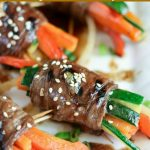 close up shot of finished Marinated Steak Vegetable Roll Up on a white platter