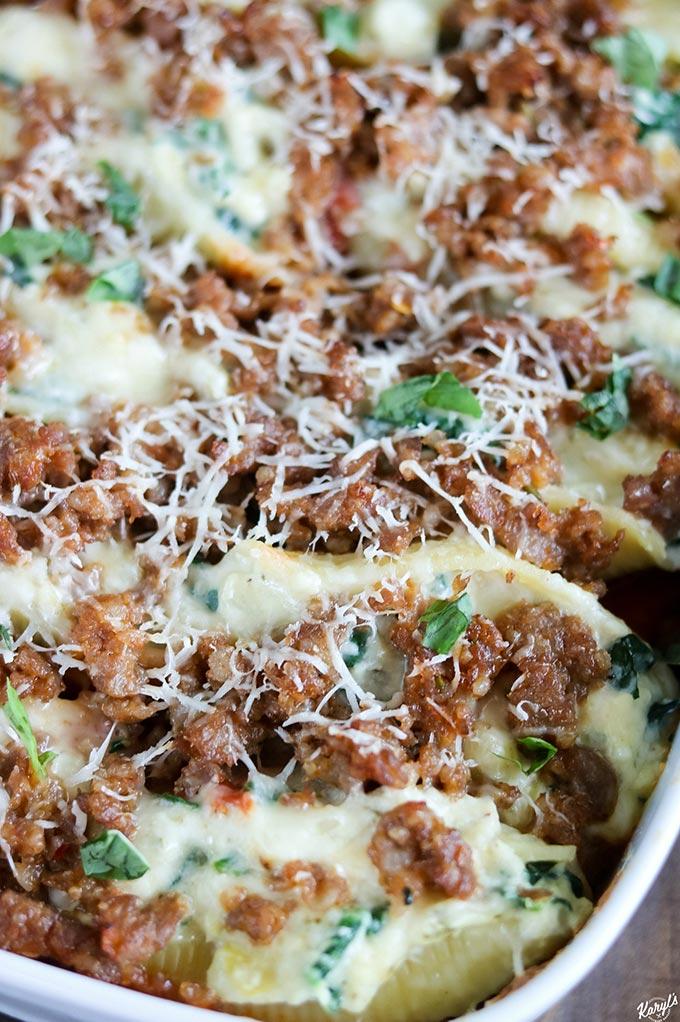 close up shot of finished Sausage Spinach Artichoke Stuffed Shells
