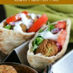 close up shot of 2 Falafel sandwiches with a bowl of Falafel on the side