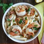 overhead shot of finished shrimp scampi in a white bowl