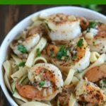 overhead close up shot of finished shrimp scampi in a white bowl