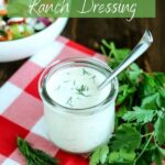 overhead angled picture of a glass jar of coconut milk ranch dressing
