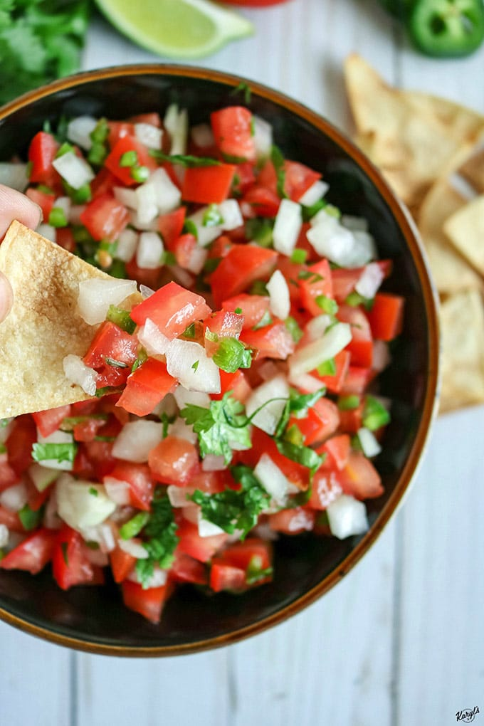 overhead shot of Pico de Gallo, with a closeup of a little bit on a chip