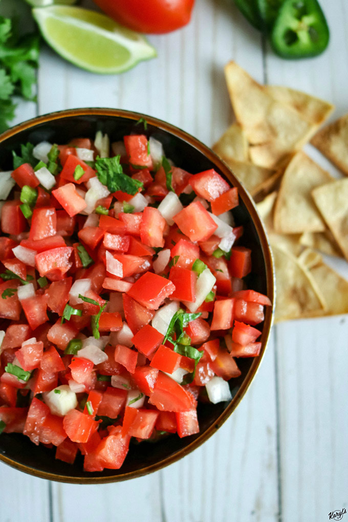 off-center shot of finished Pico de Gallo, with chips in top right corner