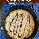 overhead shot of finished skillet chocolate chip cookie drizzled with chocolate sauce