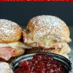 close up shot of finished Monte Cristo sliders with a side of raspberry preserves