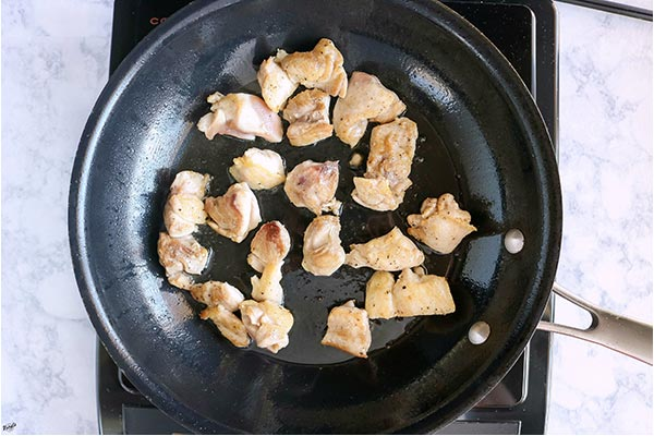 overhead process shot of chicken in skillet
