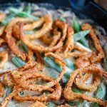 close up angled shot of finished Skillet Green Bean Casserole