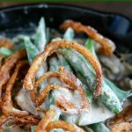 close up shot of a spoonful of Skillet Green Bean Casserole