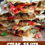 close up shot of steak fajita quesadillas in a stack on top of a board