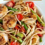 close up shot of a bowl of spicy garlic shrimp pasta