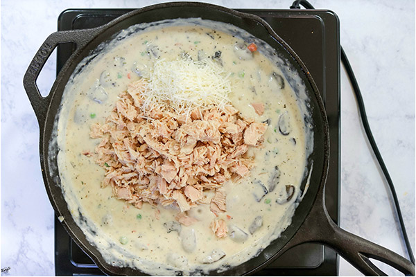 overhead process shot: tuna and Parmesan added to cream sauce mixture