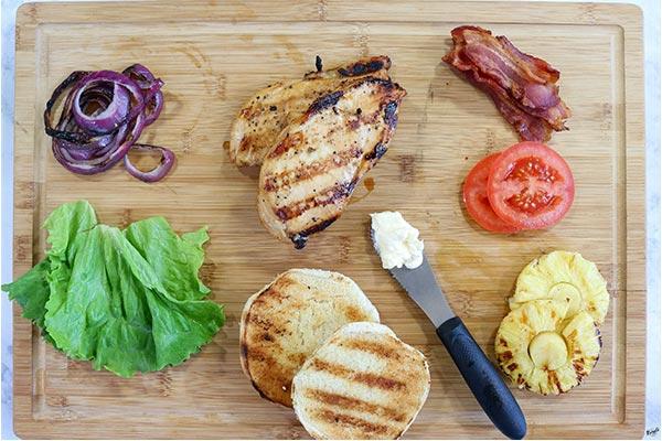 process shot: sandwich ingredients on a wood board