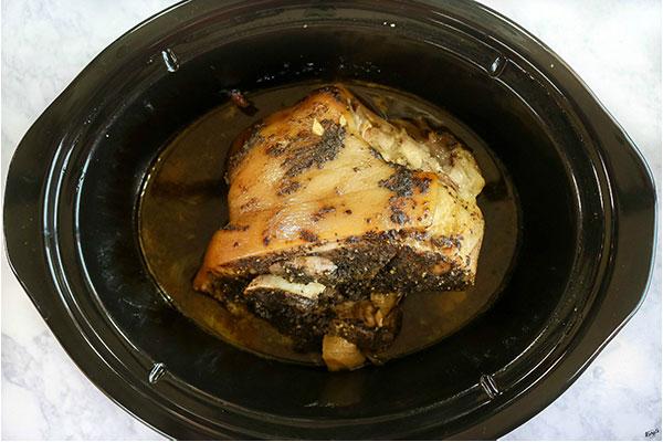 overhead process shot: finished pork inside a slow cooker