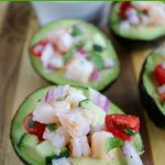 close up shot of 2 finished shrimp ceviche in avocados