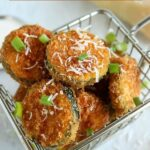 pile of panko Parmesan zucchini chips in a fry basket
