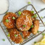 overhead shot of panko Parmesan zucchini chips in a fry basket