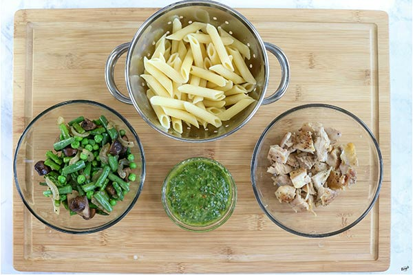 overhead process shot: ingredients in separate bowls on a wooden board