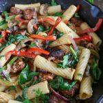 Close up shot of finished Cajun Chicken Vegetable Pasta in a cast iron skillet