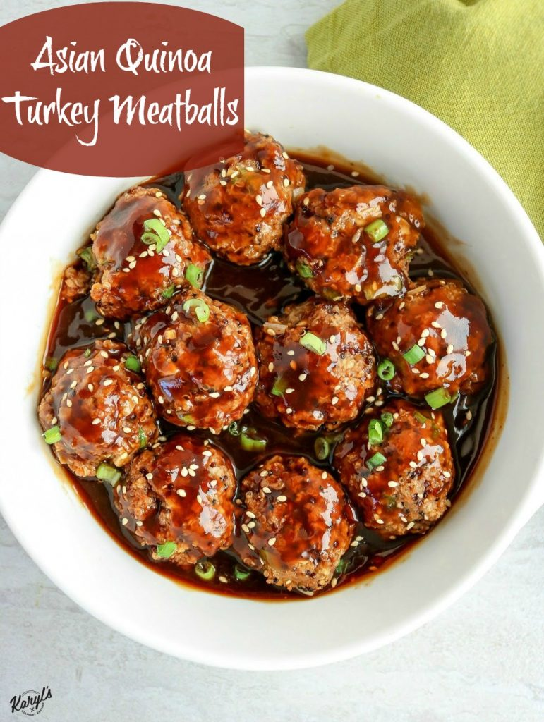 Overhead shot of finished meatballs in a white bowl with a green napkin on the side
