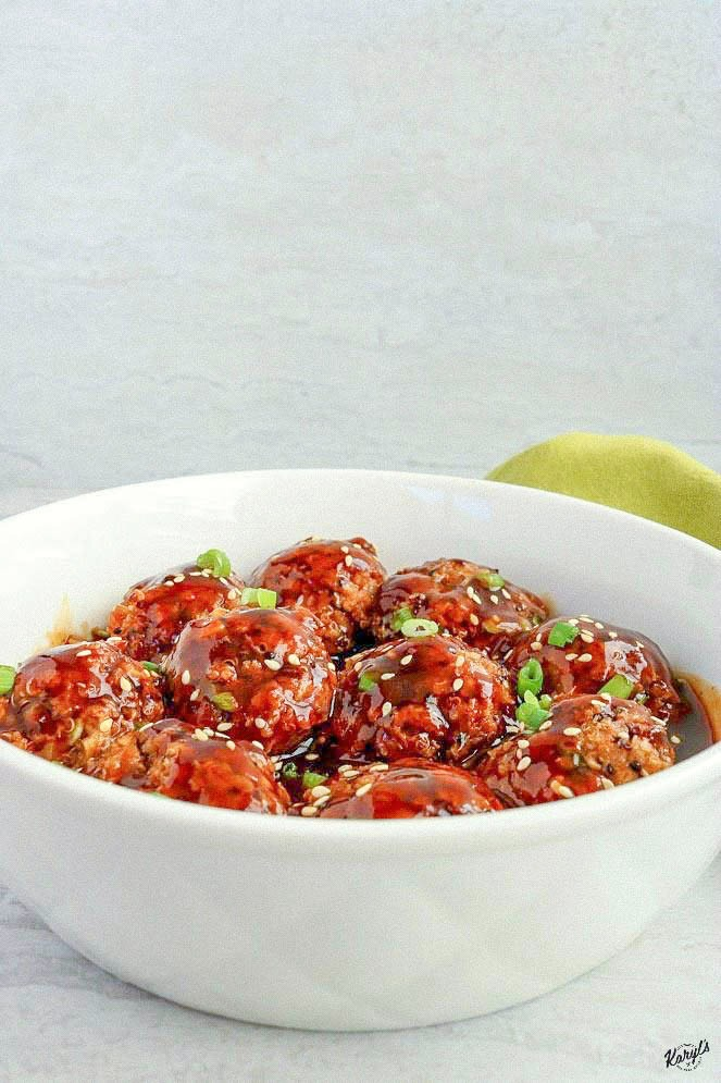 Front shot of finished Asian quinoa turkey meatballs in a white bowl