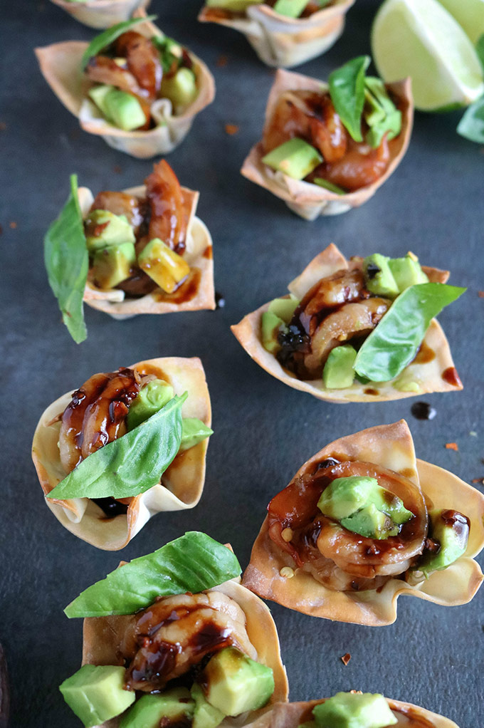 Shrimp Avocado Wonton Cups with lime wedges in the background