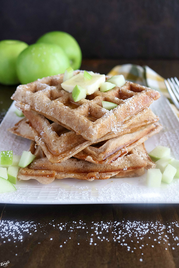 Close up shot of a stack of finished Apple Cinnamon Waffles on a white plate