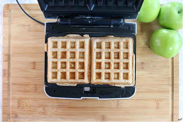 Overhead process shot of 2 waffles in a waffle iron